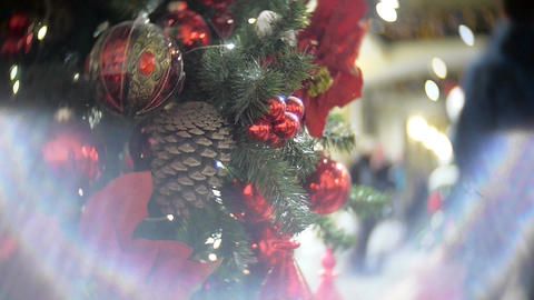 Red mirror balls and fir cone. New Year's and abstract blurred shopping mall bac Footage