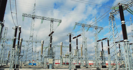 Massive metal structures at the power plant, power lines and transformers, 4k Live Action