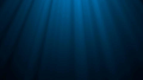 Looping animation of ocean waves from underwater. Light rays shining through Animation