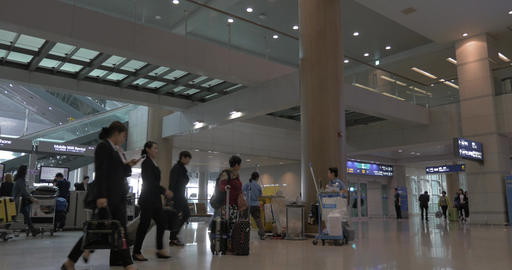 People with travel bags in Seoul airport, South Korea Footage