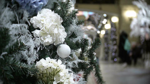Slider view of white balls and flowers. New Year's and abstract blurred shopping Footage