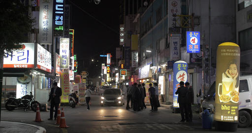 Night street with people and many store banners. Seoul, South Korea Footage