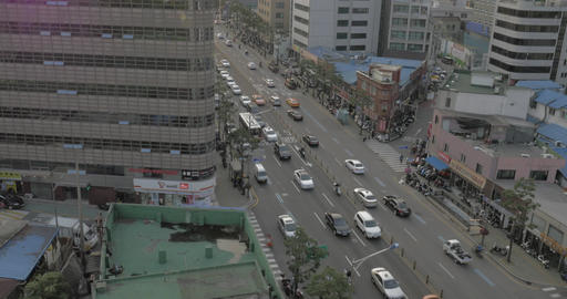 Seen busy road with passing cars, buses, motorcyclists and walking people, tower Footage