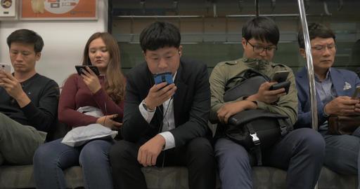 Subway passengers using cellphones. Seoul, South Korea Footage