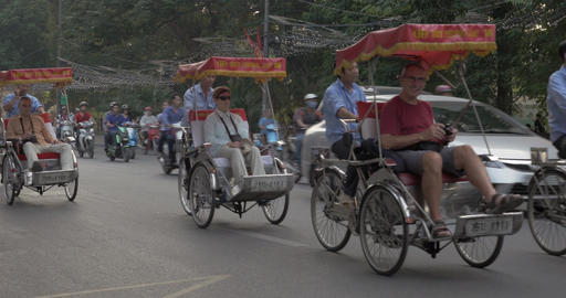 Tourists traveling by tricycle taxi in Hanoi, Vietnam Footage