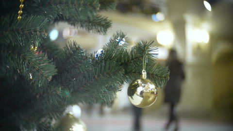 Small golden mirror ball. New Year's and abstract blurred shopping mall backgrou Live Action