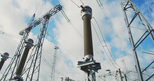 High voltage power lines and metal towers at the power station, 4k Live Action