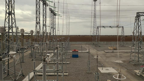 Metal towers with power lines on them at the power station, electricity, 4k Live Action