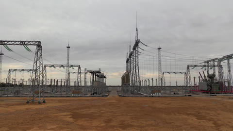 Lots of big metal structures with high voltage power lines, power station, 4k Live Action