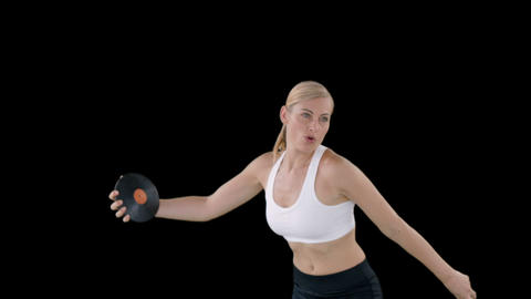 Sporty woman practising the discus throw Live Action