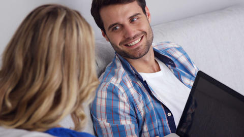 Cute couple using digital devices Footage