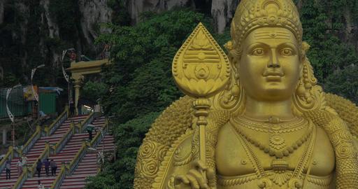 Batu Caves and giant Murugan statue in Malaysia Footage