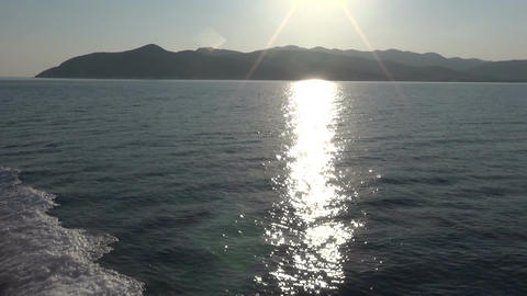 Sea Surface and Sunbeams Reflection Live Action