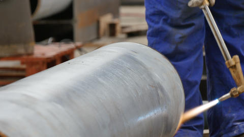 Welder Preparing a Steel Pipeline with a Blowtorch Footage