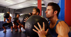 Group of people exercising with exercise ball Live Action