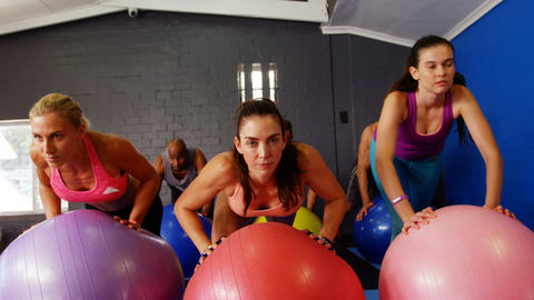 Beautiful fit women exercising on fitness ball Live Action