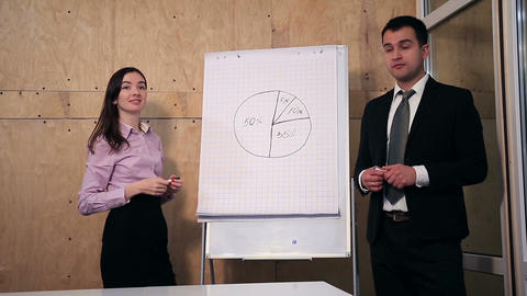 Businesspeople answer question during presentation Footage