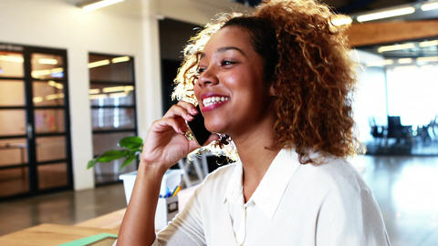 Businesswoman talking on mobile phone Live Action