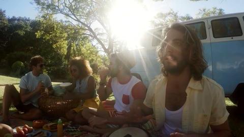 Hipster friends having fun outside camper van Live Action