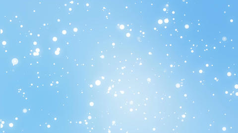 Glowing white snowflakes falling down against a light blue background Animation