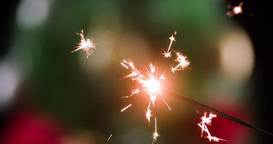 Burning sparkler refocusing decorated Christmas tree close-up video. Firework Footage