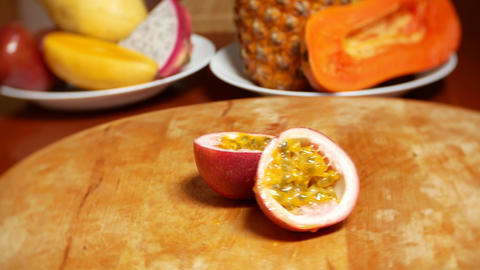 exotic fruits on the table. 4k. passion fruit, rotates on a cutting board Live Action