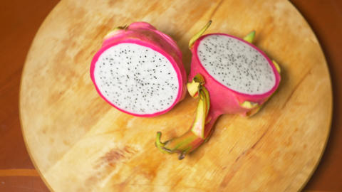 exotic fruits on the table. 4k, The dragonfruit, rotates on the chopping board Live Action