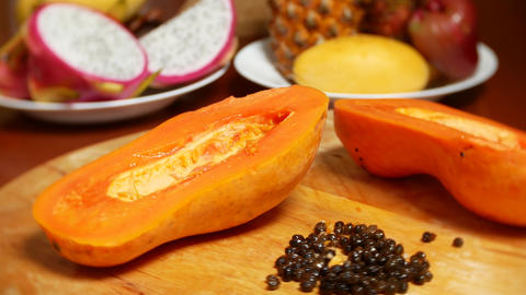 exotic fruits on the table. 4k, papaya, fruit cut into pieces, rotate on a Live Action