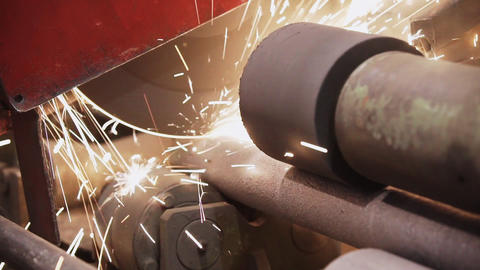 A modern metalworking machine cuts a metal pipe. band saw cutting tool steel bar Live Action