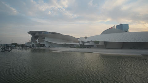 National museum of Qatar in Doha Qatar exterior zooming in shot at sunset Live Action