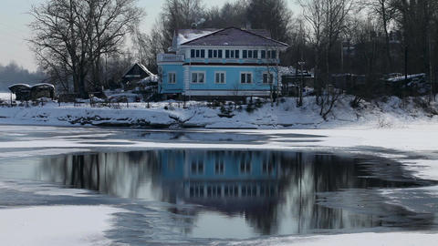 House on the river bank Stock Video Footage