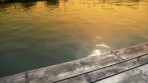 Ripples waves on lake & wood piers,sun light... Stock Video Footage