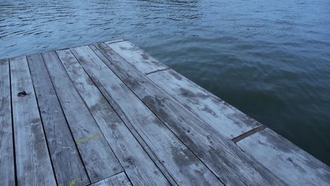 Ripples water waves on lake & wood board piers Footage