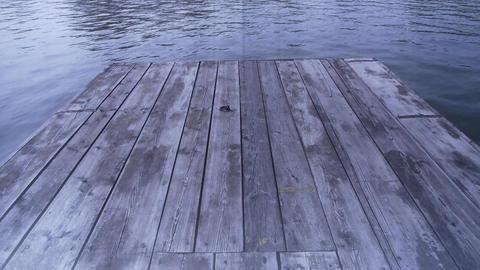 Ripples water waves on lake & wood board piers Stock Video Footage
