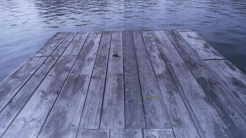 Ripples water waves on lake & wood board piers Stock Video Footage