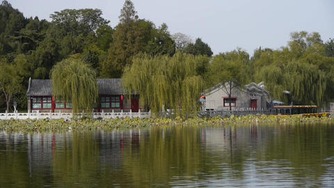 China Beijing ancient architecture Beihai Park house&willow reflected in wat Footage