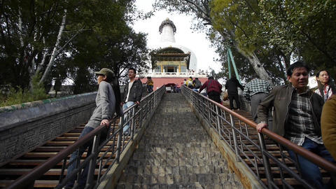 Tourist Climbing stone stairs to white-tower in beijing... Stock Video Footage