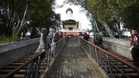 Tourist Climbing stone stairs to white-tower in beijing china Footage