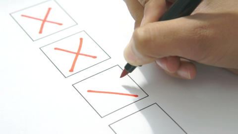 Person checking off a to do list Stock Video Footage