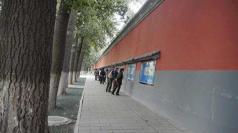 Chinese People Walking Under Beijing Imperial Red  stock footage