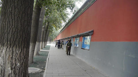 chinese people walking under Beijing imperial red Stock Video Footage