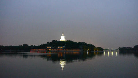 China Beijing ancient White Tower & island reflection in water Footage