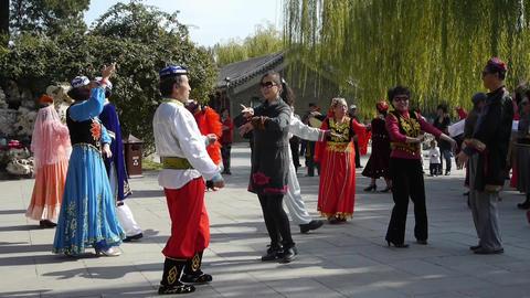 uyghur dancer under sun Stock Video Footage