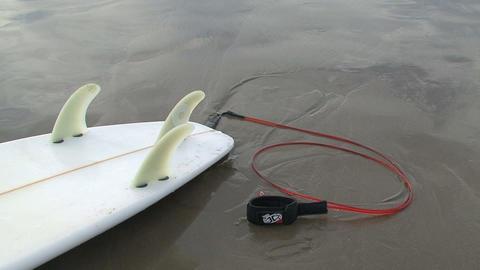 Surfboard on seashore Stock Video Footage