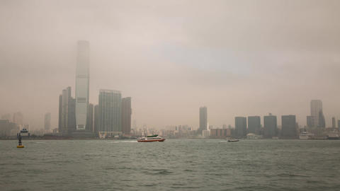 Sea Traffic on a foggy morning by ICC building Stock Video Footage