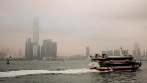 Sea Traffic on a foggy morning by ICC building Footage