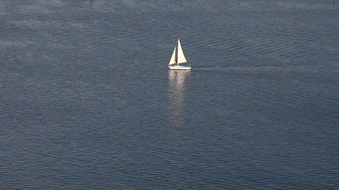 Sailing yacht on blue ocean pattern Stock Video Footage