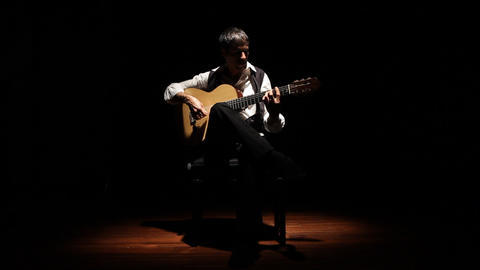 A close up of a guitarist shot being play flamenco Footage