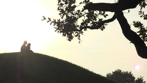 Silhouettes of couple on top of the hill Footage