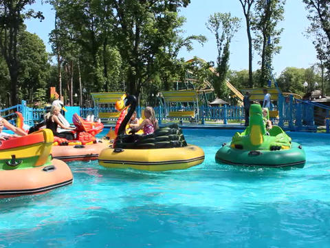 children and their parents ride water catamarans inflatable in Gorky park in Kha Footage